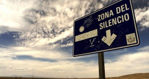 Original caption: A road sign points the way to a patch of northern Mexican desert known as the Zone of Silence, in this photo taken April 16, 2003. Many unusual phenomena have been reported within the Zone of Silence, an area of some 342,000 hectares, such as compasses spinning wildly and radios not functioning. Although most experts reject the claims of paranormal or unusual occurences, the desert landscape, also a valuable environmental reserve, maintains a mystique which attracts curiosity and fascination. REUTERS/Henry Romero --- Image by © Reuters/CORBIS