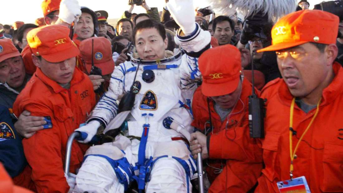 CHINA, SIZIWANG (Inner Mongolia), Oct. 16, 2003. Yang Liwei, China's first astronaut, waves to the people around him in the chief langing spot at north China's Inner Mongolia at 6:23 a.m. Thursday. (Photo by: Sovfoto/UIG via Getty Images)